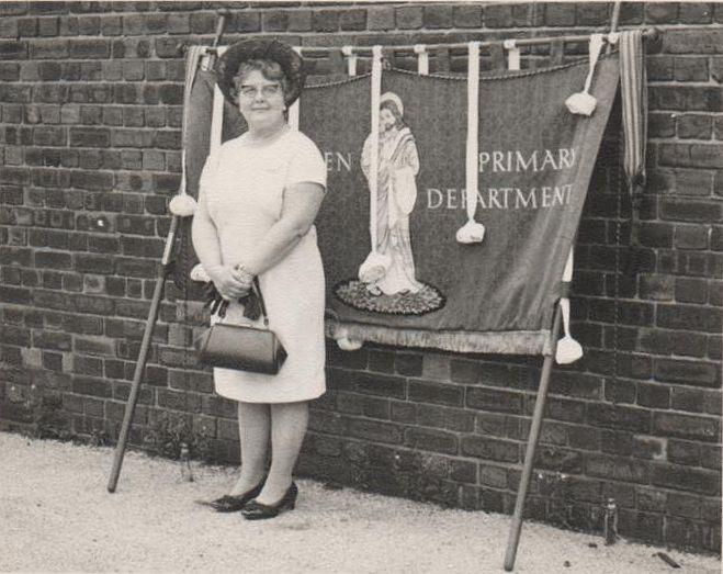 Hilda Green with Belle Green Banners in the school yard.