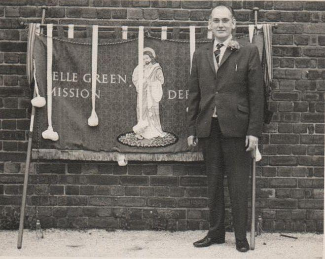 Harold Green with Belle Green Banners in the school yard.