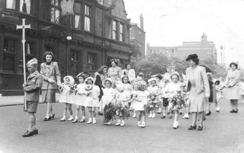In front of the Bowling Green Hotel, Wigan Lane, c1950.