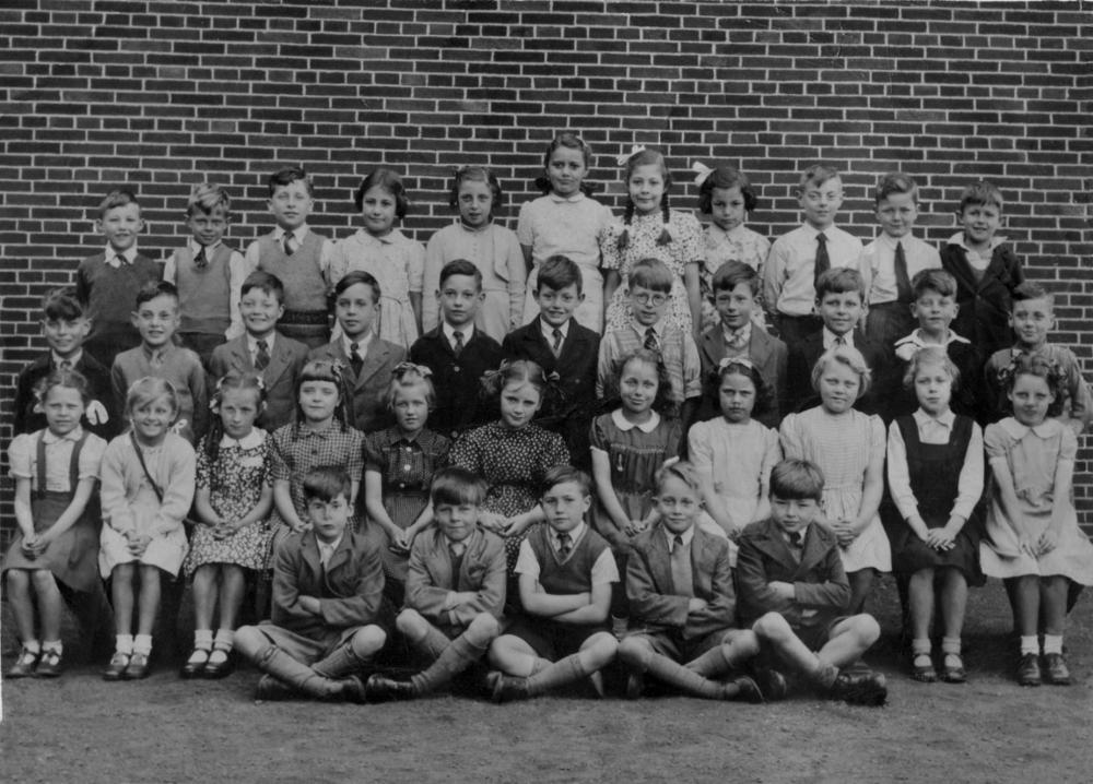 Class photo taken outside Methodist Church, which was opposite Methodist School on Dicconson Street