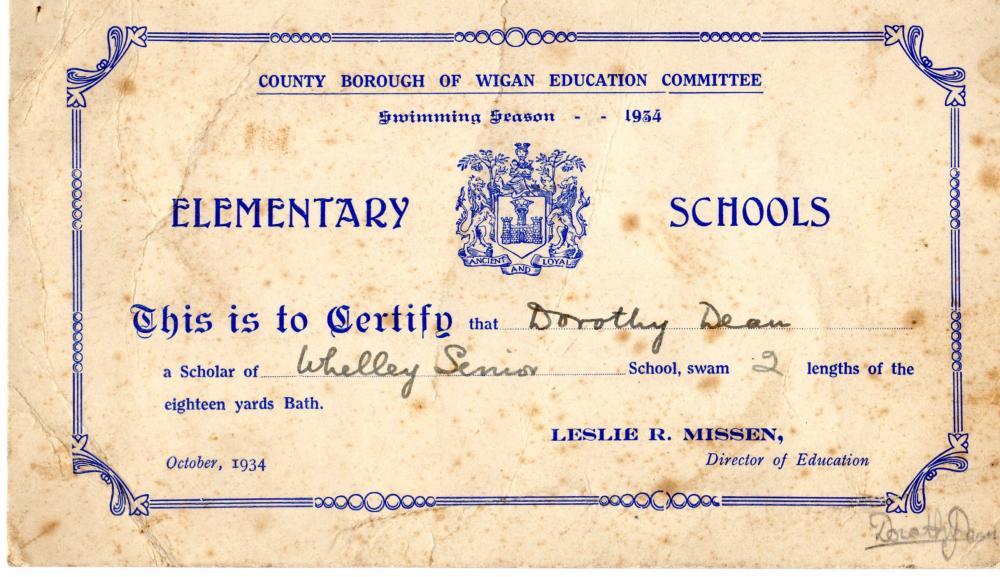 Mother's swimming certificate.