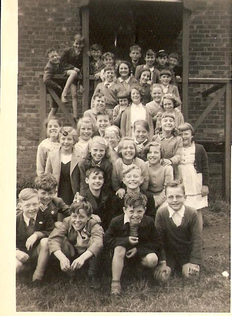 school photo (standard 5) outside parish room steps