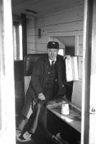 Springs Branch guard, Tommy Fagan in his brake van, July 1977.