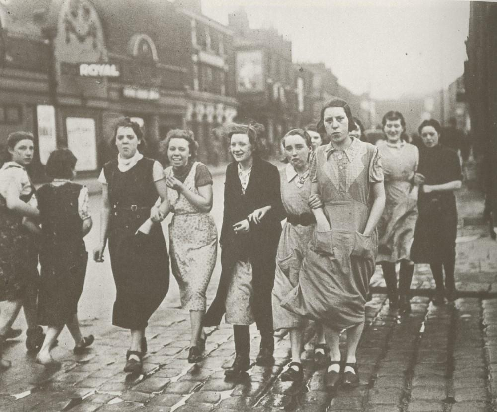 Mill girls on their way to work.