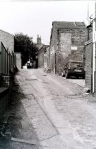 Alleyway looking up to Millgate from Station Road, 1988.