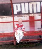 Young fan Lewiss in the dug-out.