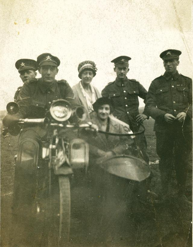 Ernest Morris riding the motor bike.
