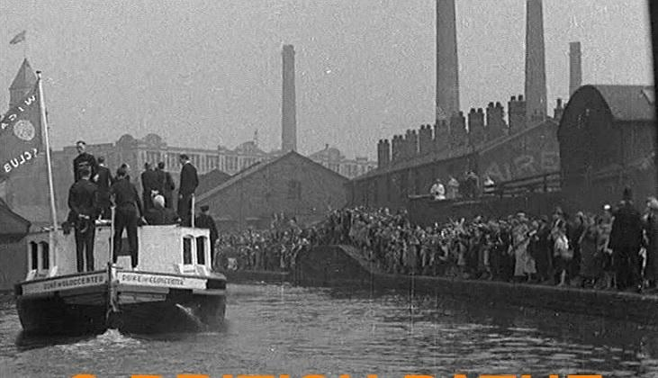 Prince Henry, Duke of Gloucester taking a ride on a barge in Wigan, 1937.