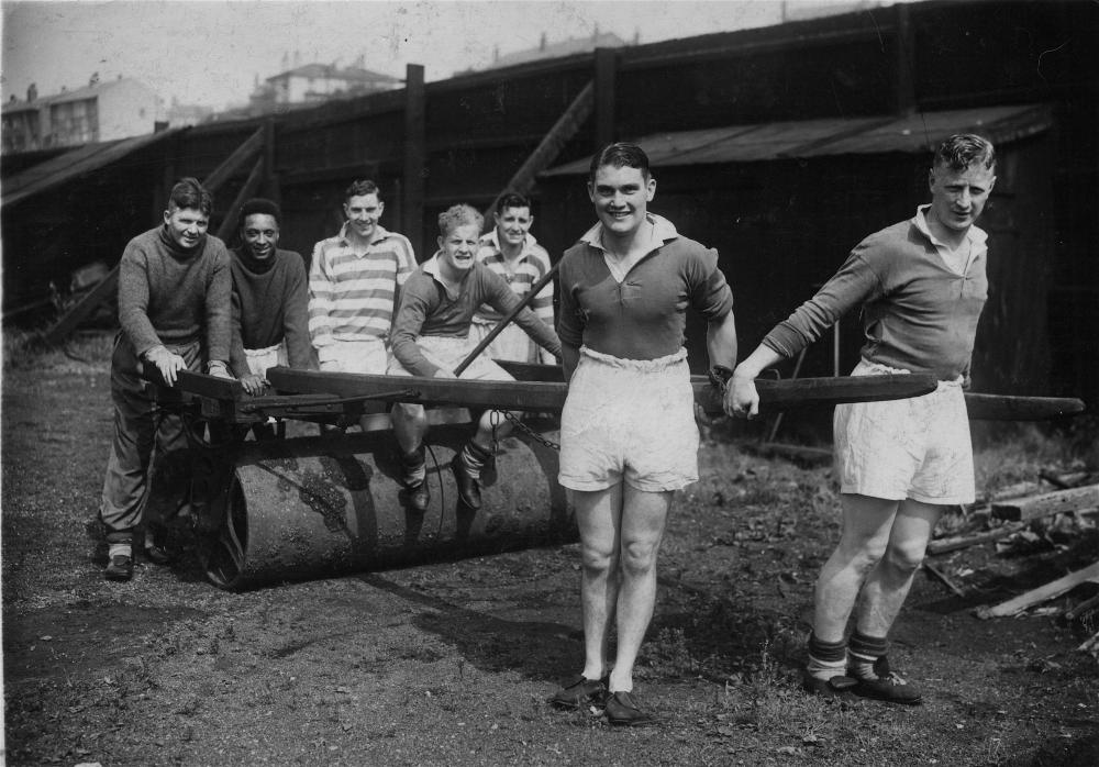 Wigan Welsh Rugby League players 1938, rolling out the roller at Central Park.