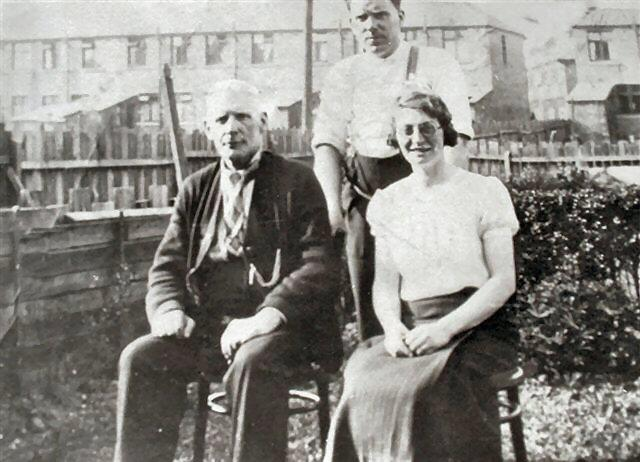 John Morris with son Billie and daughter in law Gladys (nee Pierrepoint), c1930.