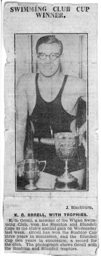 circa 1935 Ken Orrell with Wigan Swimming Club Rushton and Blundell swimming trophies.