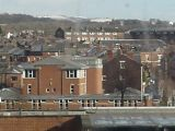 View over Wigan centre towards snow-covered hills. (Rivington?)