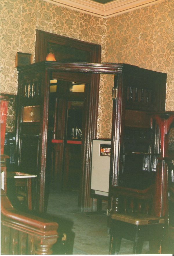 Cigarette machine in entrance to back lounge