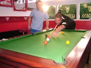 Playing pool for a small wager